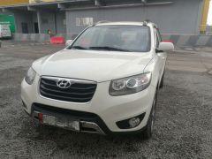 Hyundai Santa Fe II Рестайлинг 3.5, 2011 г., $ 13 500